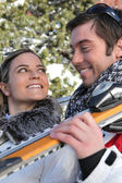 Smiling young couple at ski — Stock Photo