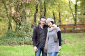 Couple taking an autumn stroll — Stock Photo