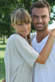 Portrait of a young couple in the countryside — Stock Photo