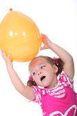 Girl with an orange balloon — Stock Photo