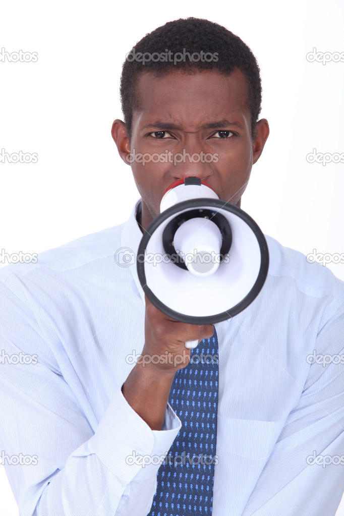 Office worker shouting into megaphone — Stock Photo #8163679