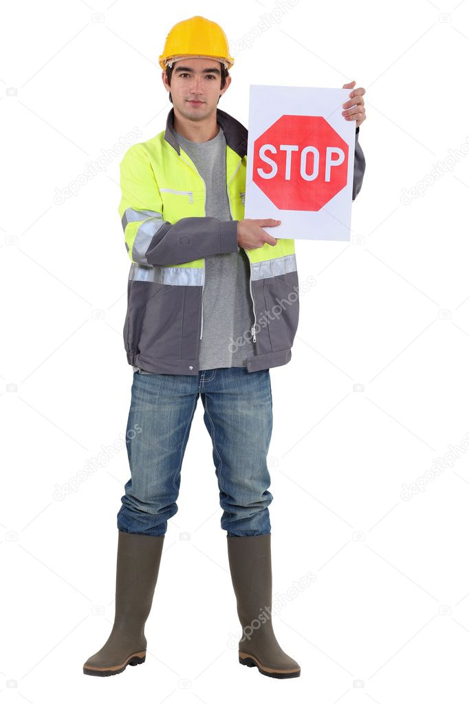 A road worker holding a stop sign. — Stock Photo #8164521