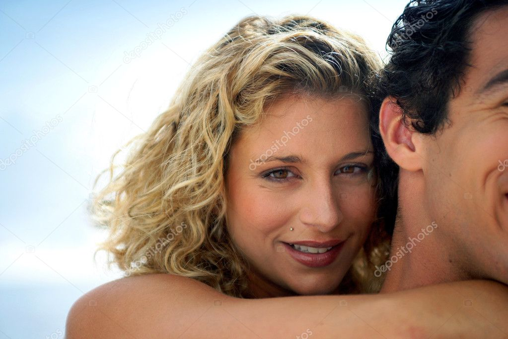 Gorgeous woman embracing her boyfriend — Stock Photo #8165876