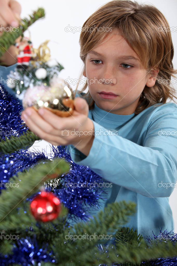 Little boy decorating Christmas tree — Stock Photo #8166855