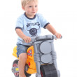 Young boy on a toy bike — Stock Photo #8170000