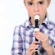 Little girl playing a recorder — Stock Photo
