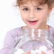 Little girl with marshmallows on white background — Stock Photo
