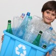 Child recycling plastic bottles - Zdjęcie stockowe