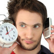 Man with alarm clock and mobile phone — Stock Photo #8170242