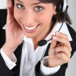 Happy brunette call-centre worker — Stock Photo