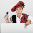 Scottish womwith mobile phone — Stock Photo #8170621