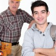 Builder and a college student — Stock Photo