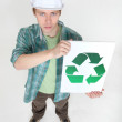 Man holding recycle logo — Stock Photo