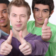 Stock Photo: Young men with thumbs up