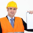 An architect presenting a blank clipboard. — Stock Photo
