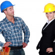 Foto Stock: Architect and builder flirting