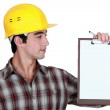 Construction woman with a clipboard — Stock Photo