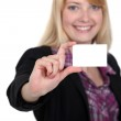 Woman holding up her business card — Stock Photo