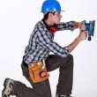 Stock Photo: Tradesmusing sander