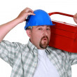 Stock Photo: Mcarrying tool box on shoulders