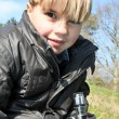 Young boy with a microscope outdoors — Stock Photo