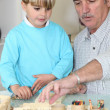 Stock Photo: Grandfather spending quality time with his grandson
