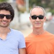 Grandfather and grandson with sunglasses — Stock Photo