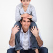 Son sat on father's shoulders — Stock Photo