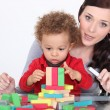 Little boy playing with building blocks — Stockfoto