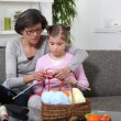 Mother and daughter knitting — Stock Photo