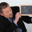 Businessman with 5/5 written on a chalkboard — Stock Photo