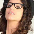 Pretty woman in silly glasses and a hat — Stock Photo