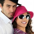 图库照片: Couple wearing funny hats