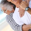 Middle-aged couple hugging at the beach — Stock Photo #8178595