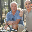 Stock Photo: Portrait of two friends on bikes