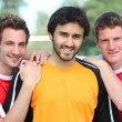 Stock Photo: Portrait of 3 football players