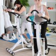 Stock Photo: Women using stepper machine in gym