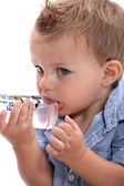 Boy sucking bottle — Stock Photo