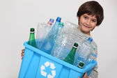 Child recycling plastic bottles — Stok fotoğraf