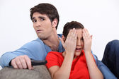 Couple watching a scary film — Stock Photo