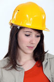 A sad female construction worker. — Stock Photo