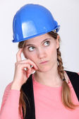 Pensive tradeswoman — Stock Photo
