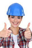 Smiling tradeswoman giving two thumb's up — Stock Photo