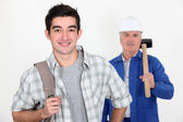 Young apprentice and mason — Stock Photo