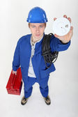 Portrait of young electrician holding alarm — Stock Photo