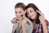 Two women applying make-up — Stock Photo