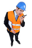 Engineer shouting into a two-way radio — Stock Photo