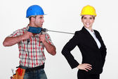 Craftsman threatening his boss with a drill — Stock Photo