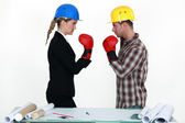 Architect and builder boxing — Stock Photo