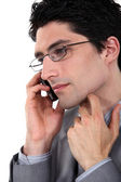 Closeup of a bespectacled businessman on the phone — Stock Photo